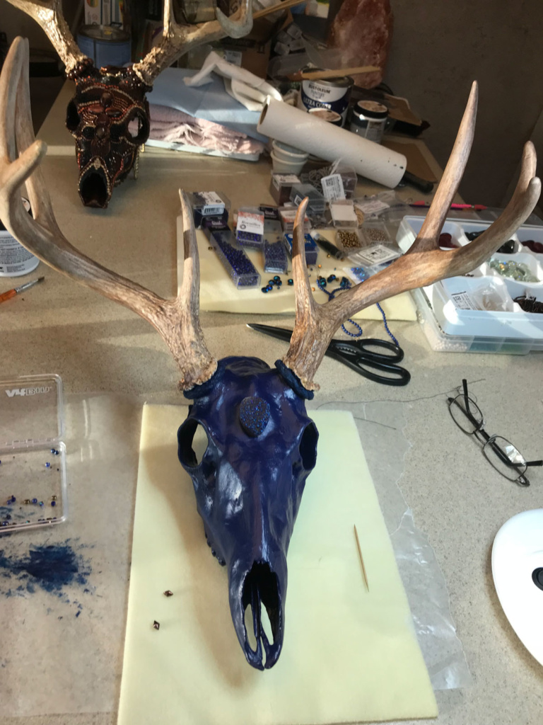 The Whitetail buck skull painted and ready to bead.