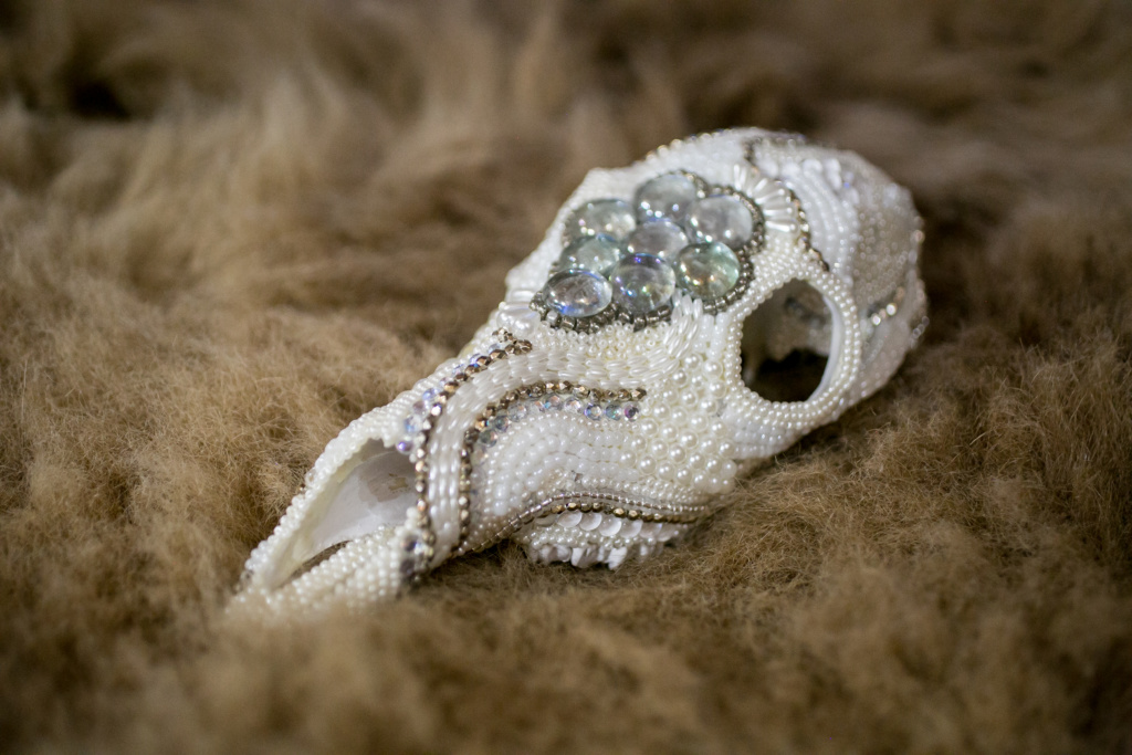 Whitetail Doe, White Beaded Skull on a fur rug.