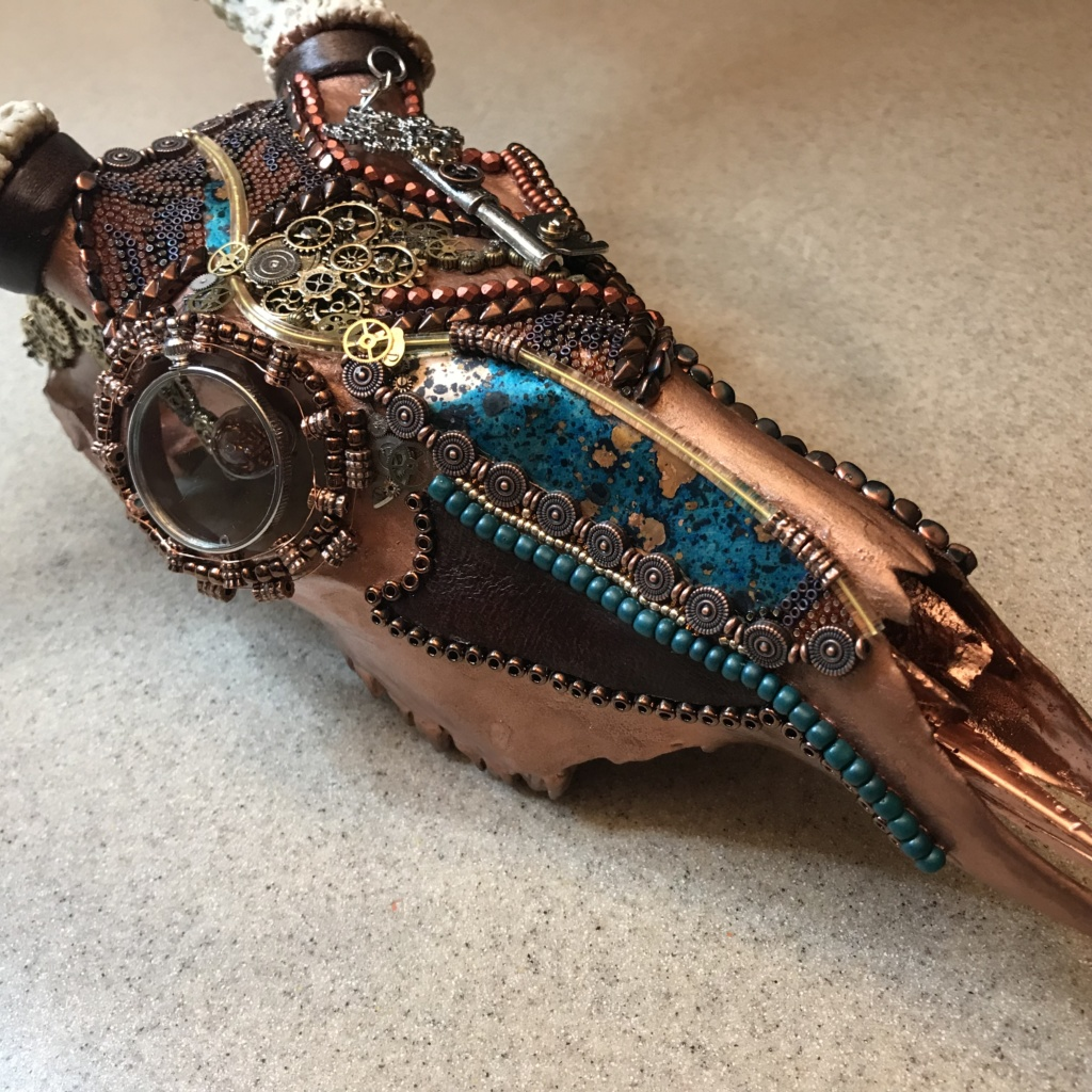 The continued beading process and naming of Grand Chaos, Steampunk buck skull art piece.