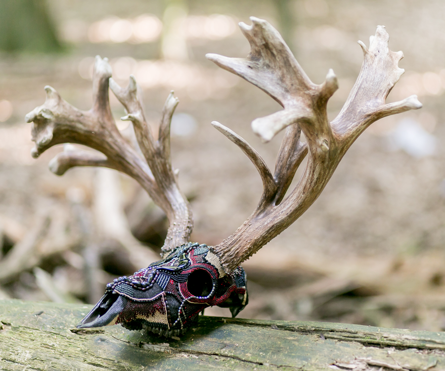 Thor, a non-typical whitetail beaded skull art piece.