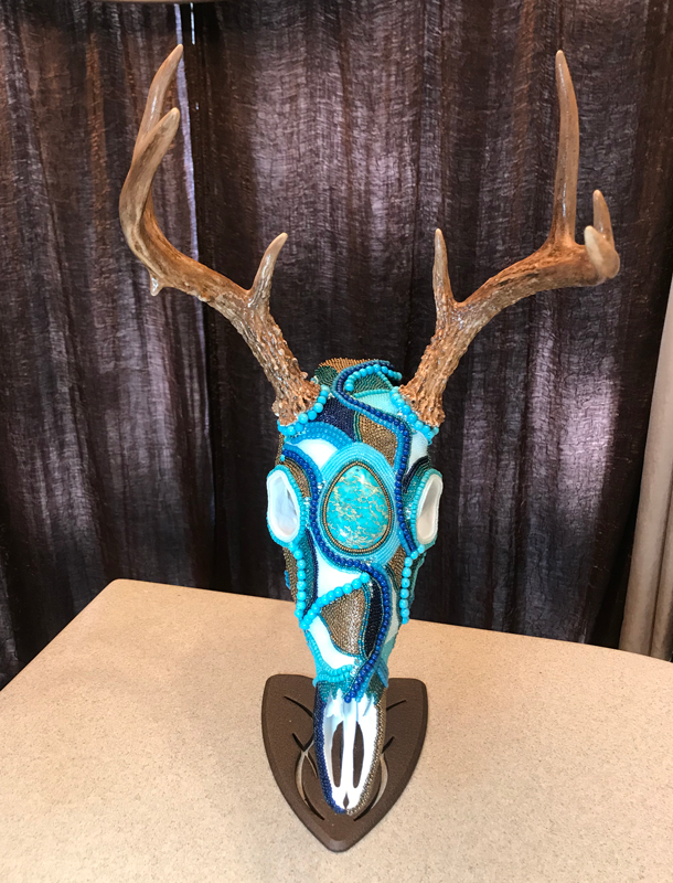 Devon's Legacy, a whitetail buck keepsake beaded skull art work.